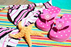 Flip Flops and Bathing Suit by Pool Stock Images