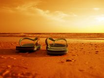 Flip-flops at the beach. An image of flip-flops at the beach Stock Photo
