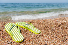 Flip flops at the beach. Summer vacation with flip flops at the beach royalty free stock image