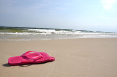 Flip flops on beach Stock Images