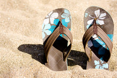 Flip flops on the beach Stock Photo