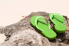 Flip flops on the beach Stock Photography