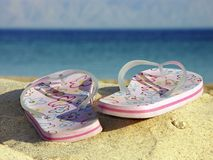 Flip-flops on beach. Holiday at the seaside - flip-flops on beach Stock Images