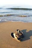 Flip flops on beach Stock Image