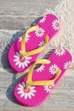 Flip flops at beach. Pretty flip flops in morning sun on sandy beach boardwalk royalty free stock photo