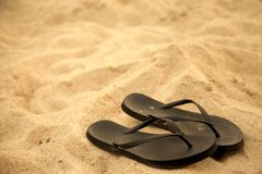 Flip flops on beach Stock Photography