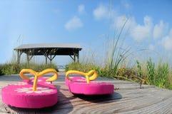 Flip flops on beach boardwalk Stock Photo