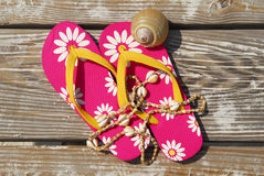 Flip flops on beach boardwalk Royalty Free Stock Photos