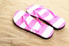 Flip flops on a beach. Flip flops on beach, close up Stock Photos