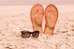 Flip-flops on a beach Stock Photography