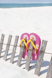 Flip flops on beach fence Stock Images