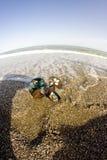 Flip flops on the beach fisheye look Stock Images