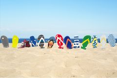 Flip-flops on the beach. Summer holidays at the sea royalty free stock photography