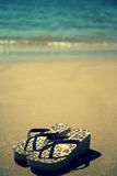 Flip flops on the beach royalty free stock image