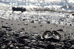 Flip-flops on beach. A pair of Flip-flops on beach Stock Images