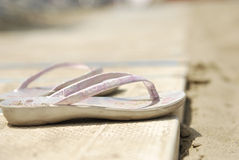Flip-flops on the beach. A pair of Flip-flops on the beach Royalty Free Stock Photography