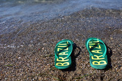 Flip flops on the beach Stock Images