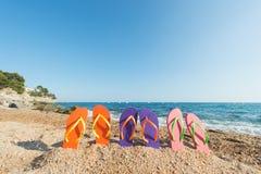 Flip flops at the beach Stock Photos