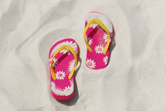 Flip flops in beach sand Royalty Free Stock Photo
