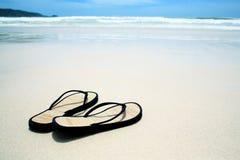 Flip flops on the beach Stock Photos