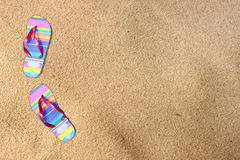 Flip flops on beach sand. room for text. Royalty Free Stock Image