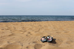 Flip Flops on the Beach Sand. Under the Sun Royalty Free Stock Image
