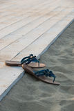 Flip flops on the beach. Flip flops on the sandy beach Stock Photo