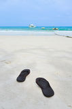 Flip flops on beach. Flip flops on a sandy ocean beach Royalty Free Stock Photos