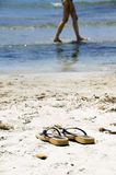 Flip flops on the beach Stock Photos