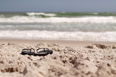 Flip flops at the beach Stock Images