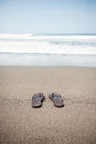 Flip flops on beach Royalty Free Stock Photography