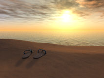 Flip flops on a beach at sunset. Royalty Free Stock Photography