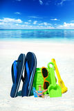 Flip Flops and beach toys Stock Image