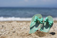 Flip flops on a beach Royalty Free Stock Photo
