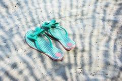 Flip flops on a beach Stock Photography