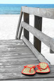 Flip flops on beach walkway Royalty Free Stock Images