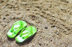 Flip flops on the beach. Wet flip flops on the beach stock photos