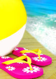 Flip Flops and Beachball by Ocean Stock Photos