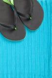 Flip-flops on blue color towel background Stock Image