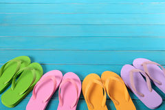 Flip flops with blue decking Royalty Free Stock Photography