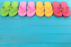 Flip flops with blue decking. Summer beach flip flops row copy space royalty free stock photo