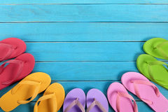 Flip flops with blue summer beach deck, copy space Royalty Free Stock Photography