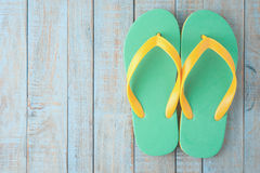 Flip-flops on blue wood.Summer holiday background concept Royalty Free Stock Photo