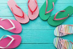 Flip flops on blue wooden floor background. Top view and copy space. Summer fun holidays. Beach Sandals. Flip flops on blue wooden floor background. Top view and stock images