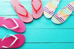 Flip flops on blue wooden floor background. Top view and copy space. Summer fun holidays. Beach Sandals. Flip flops on blue wooden floor background. Top view and stock image