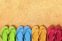 Flip flops border, summer beach background, copy space. Flip flops in a row, beach sand background royalty free stock photos