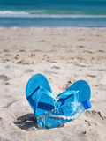 Flip-flops and bottle Stock Image