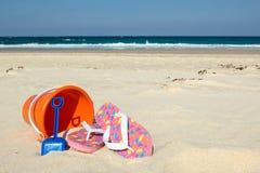 Flip-flops, bucket & spade Stock Photos