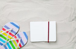 Flip flops and classic notebook with pencil Royalty Free Stock Image