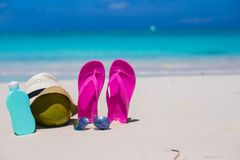 Flip flops, coconut, hat and suncream on white Stock Photography